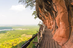 Beautiful Wooden bridge in red cliffside at Wat Phu tok mountain Royalty Free Stock Photo