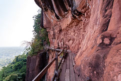 Beautiful Wooden bridge in red cliffside at Wat Phu tok mountain. Bueng Kan, Thailand Stock Photo