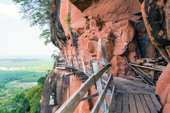 Beautiful Wooden bridge in red cliffside at Wat Phu tok mountain Stock Photography