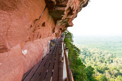 Beautiful Wooden bridge in red cliffside at Wat Phu tok mountain Royalty Free Stock Photo