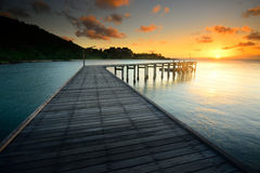 The beautiful wooden bridgewith sunrise at national park Khao L Royalty Free Stock Photos