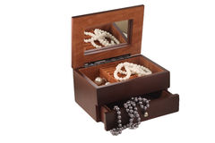 Beautiful Wooden casket with a mirror and a neckla Royalty Free Stock Photography