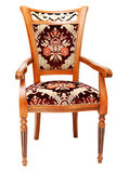 Beautiful wooden chair with expensive drapes Royalty Free Stock Photo