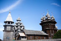 Beautiful wooden church cupolas with crosses at summer day royalty free stock photos