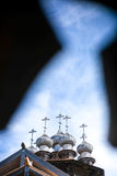Beautiful wooden church cupolas with crosses at summer day royalty free stock image
