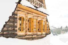Beautiful wooden cottage covered in snow, ski resort Donovaly Royalty Free Stock Images