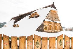 Beautiful wooden cottage covered in snow, ski resort Donovaly Royalty Free Stock Photography