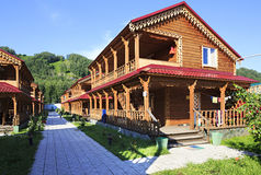Beautiful wooden cottages in the mountains. Royalty Free Stock Photo