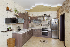 Beautiful wooden country style kitchen with stone decor in yello Stock Photo