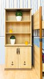 Beautiful wooden cupboard in children's room Stock Images