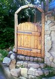 Wooden door in white stone wall royalty free stock images