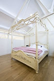 Beautiful wooden double bed Royalty Free Stock Photos