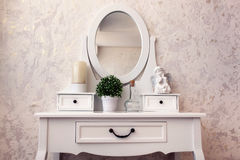 Beautiful wooden dressing table with mirror on white background wallpaper Royalty Free Stock Image