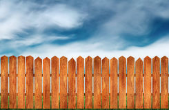 Wooden fence. Beautiful wooden fence with natural wood pattern slats royalty free stock image
