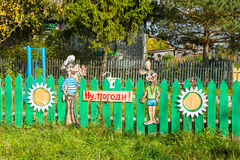 Beautiful wooden figures adorn the fence of rural house. Royalty Free Stock Photos