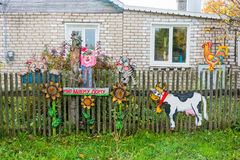 Beautiful wooden figures adorn the fence of rural house. Royalty Free Stock Photography
