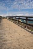 Beautiful wooden footbridge on atlantic coast in blue sky Royalty Free Stock Image