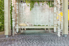 Beautiful wooden front porch swing with comfortable pillows Royalty Free Stock Photography