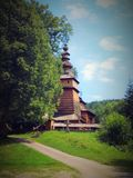 Old wooden Greek orthodox church. Beautiful wooden Greek orthodox church in Kotan in podkarpackie region in southern Poland sorrounded by old trees. Built in Stock Photography