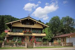 Beautiful wooden house and barn in the village Brixen im Thale in Austria. stock image