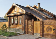 Beautiful wooden house with carved front Royalty Free Stock Photos