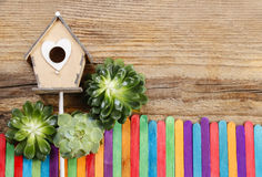 Beautiful wooden house and colorful fence (miniatures) Stock Photos