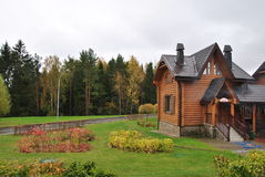 Beautiful wooden house in a forest in the autumn. Wooden house in the ski resort `silichi` Belarus Royalty Free Stock Photo