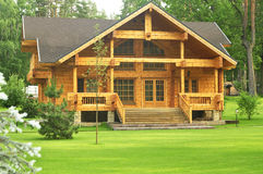 Beautiful wooden house in the forest Royalty Free Stock Photography