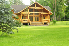 Beautiful wooden house in the forest Stock Images