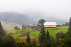 Beautiful wooden house on a green hill Royalty Free Stock Images