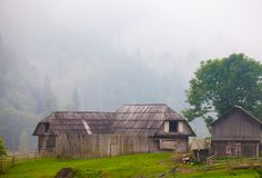 Beautiful wooden house on a green hill Stock Photography