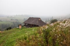 Beautiful wooden house on a green hill Stock Photos