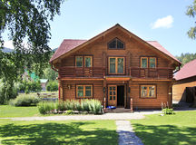 Beautiful wooden house in the mountains. Altai. Stock Photos