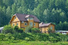 Beautiful wooden house near the forest, ecological home Royalty Free Stock Photos