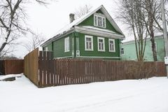 Beautiful wooden house in the village, built in the early twentieth century. Traditional Russian village house of green color with stove heating, with carved stock images