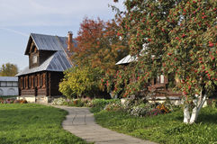 Beautiful Wooden House With Rowan-trees In Autumn Royalty Free Stock Photo