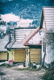 Beautiful wooden houses in Vlkolinec village, Slovak republic, Unesco. Cultural heritage. Travel destination. Vertical composition. Analog photo filter with stock photography
