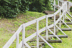 Beautiful wooden ladder leads up the hill augsup Royalty Free Stock Photography