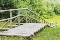 Beautiful wooden ladder leads up the hill augsup Stock Images