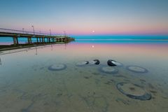 Beautiful wooden pier on Baltic sea shore Royalty Free Stock Photo