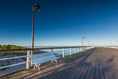 Beautiful wooden pier on Baltic sea shore Stock Image