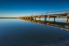 Beautiful wooden pier on Baltic sea shore Stock Photos