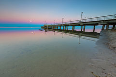 Beautiful wooden pier on Baltic sea shore Royalty Free Stock Photography