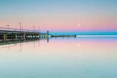 Beautiful wooden pier on Baltic sea shore Stock Photo