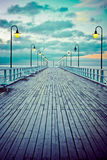 Beautiful wooden pier at sunrise Stock Image