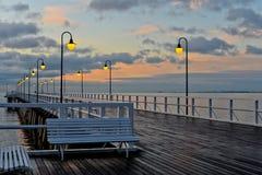 Beautiful wooden pier at sunrise Stock Photo