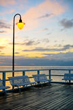 Beautiful wooden pier at sunrise Stock Images