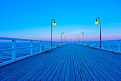 Beautiful wooden pier at sunset Royalty Free Stock Photo