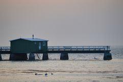 Beautiful wooden pier in the Sweden,Malmo. One of many beautiful wooden piers with green fishing hut in the Sweden, Malmo Stock Photo