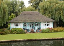 Riverside Thatched Cottage. Royalty Free Stock Images